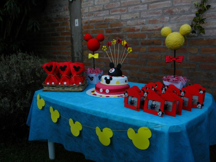 Mickey Mouse birthday table set up, goodie bags, cake and ...