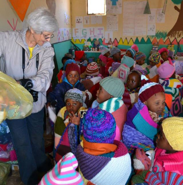 ANTICIPATION - while the hats and blankets are being given out, the children are very quiet and orderly... but when Ronda brings out the bag of cuddly toys to distribute, there squeals of delight, and everything gets a bit chaotic!!!  www.knit-a-square.com