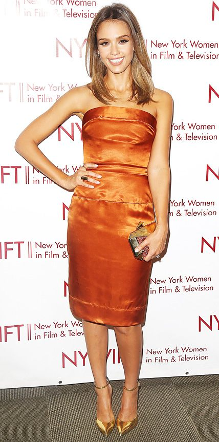 Jessica Alba glistened at the Film and Television Designing Women Awards Gala in a strapless copper Vivienne Westwood cocktail dress, sticking to the metallic theme with glittery Kotur clutch and gold ankle-strap Giuseppe Zanotti pumps.