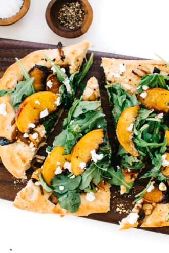 Arugula, Roasted Peach & Goat Cheese Flatbread – In our column Intuitive Eating with Kale & Caramel, blogger Lily Diamond presents recipes meant to balance the body and inspire the senses.