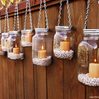Mason Jar Lanterns Hanging Tea Light by TheCountryBarrel on Etsy, could be cute hanging in trees