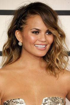 Chrissy Teigen - http://www.dailymakeover.com/trends/hair/top-10-celebrity-braid-hairstyle/?utm_source=Sailthru&utm_medium=email&utm_term=Dailymakeover%20Newsletter%20-%20new%20or%20opened%2045%20days%20%28E%29&utm_campaign=DM%20Newsletter%20-%20Automated%20%28Daily%29%202014-03-18#slide7