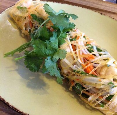 Tempura prawn and papaya salad, wrapped in an egg net