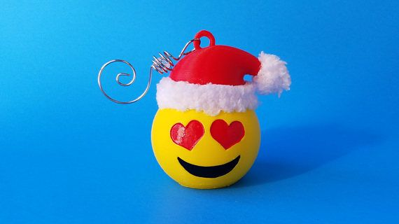 Santa Emoji Holiday Ornament  Ho, ho, ho!   Hang a little love from your tree this year with a Santa themed, Heart Eyes Emoji Ornament!  3D printed from PLA biodegradable plastic.   Hand-painted using acrylic paints and includes a furry polyester hat trim and ball.  ******Tree hanger not included.******  #christmas #ornament #santaclaus #emojis #hearts #etsy #etsyseller #EtsyShop