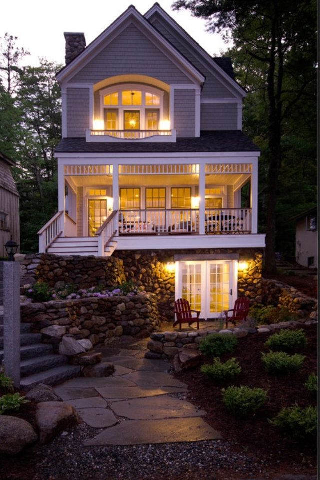 lake front cottage with a stunning staircase - Lake Front Home Designs