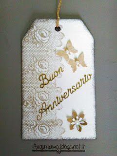 Una tag per un anniversario da un pezzo di carta riciclato  Tag dorata per un cinquantesimo