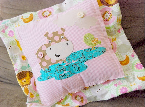 Add some style to your nursery with this darling pillow made with Create a Critter and Nate's ABC's! #cricut