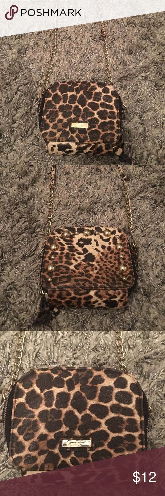 Jessica Simpson leopard cross-body purse NWOT This bag is in perfect condition, I've never worn it out. The bag is funky and cute and perfect for any solid color outfit! Has two great compartments to hold anything you could need including multiple cards and cash! Happy to negotiate and answer any questions. 😊 Jessica Simpson Bags Crossbody Bags
