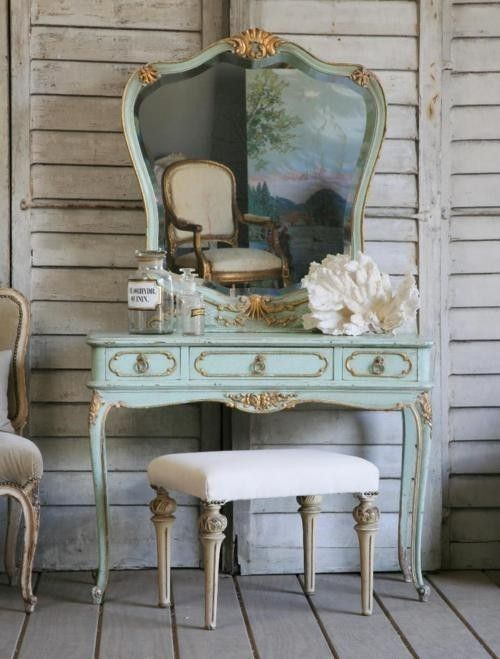 The mint and gold on this dressing table is very ornate and louie style. Paired with natural linens to calm the detail. - Bridal suite