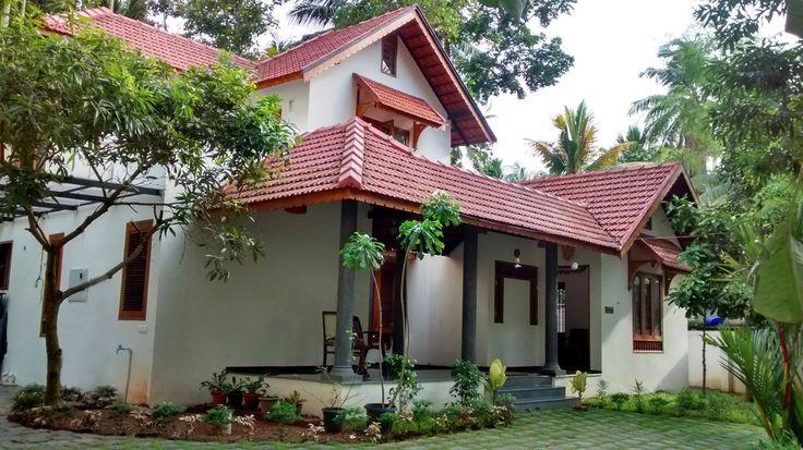 Traditional Kerala Style Residence designed around an existing Jackfruit Tree.