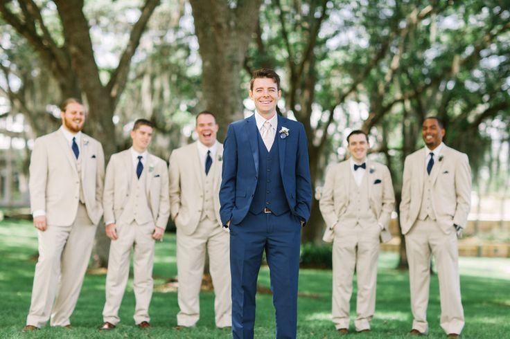 Southern pink, navy, and gold wedding. Gorgeous wedding details with Betsy Johnson heals, white rose bouquet, pink twist wrap bridesmaids dresses, navy suite and khaki suite groomsmen, ruffled bridal gown. Rustic and vintage details complete this elegant southern siore in florida at Up the Creek Farms. Wedding Photography by Kati Rosado. Film and digital photography in Central Florida.