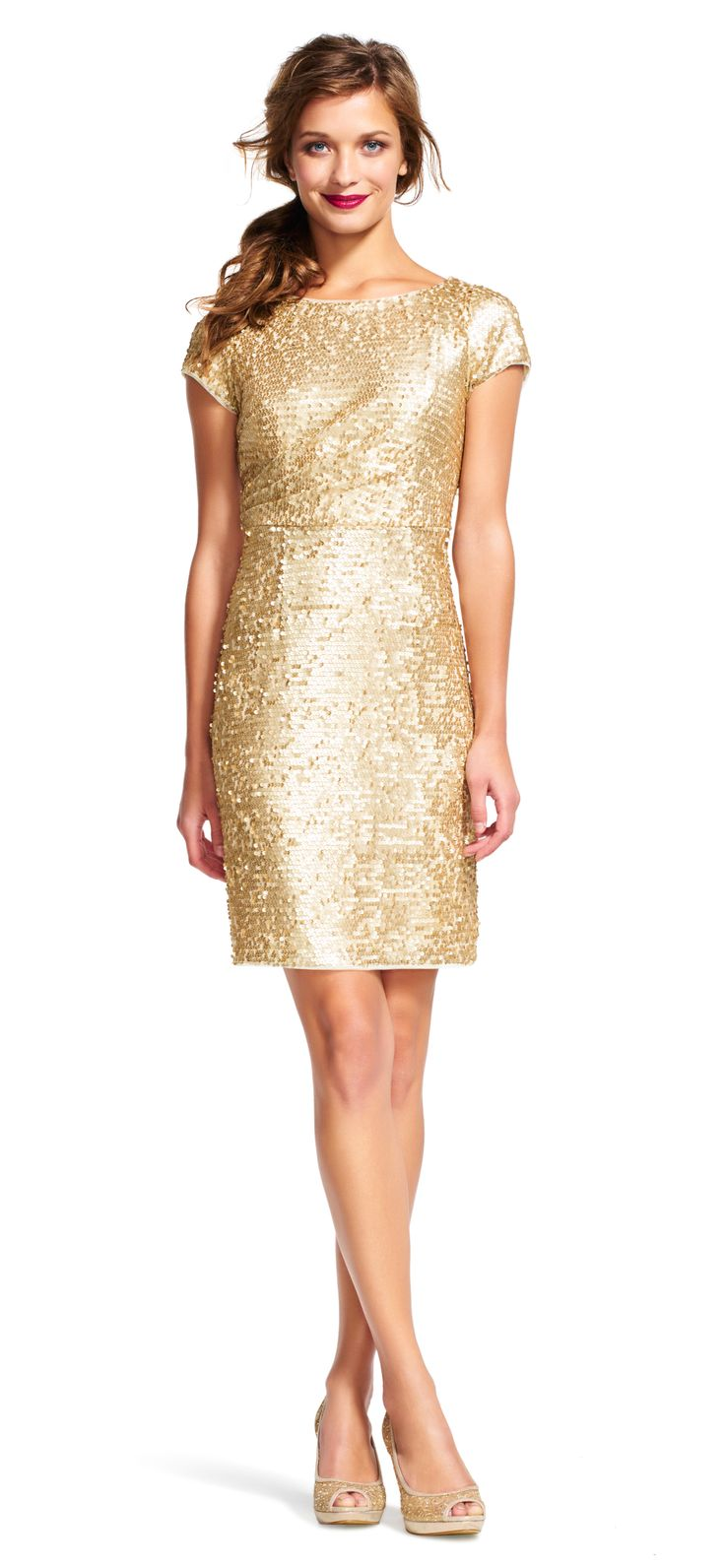 All over sequins is the sparkly thing your dress collection needs. This cocktail dress features a scoop neckline, short sleeves and a sheath silhouette. Simple and glamorous, this party dress is effortless. Paired with a neutral pump and simple earrings, this dress is ready for cocktail hour.