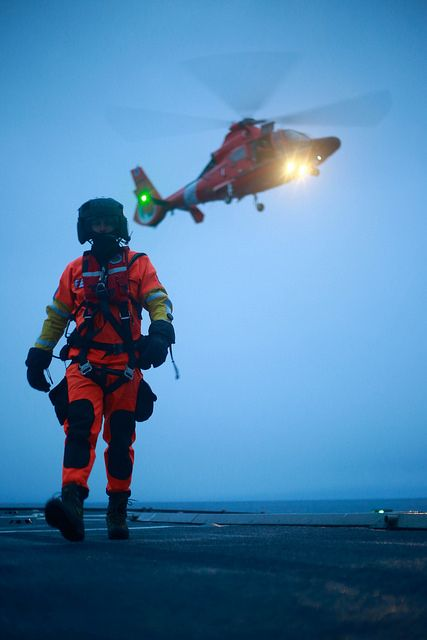 Flight Deck. Petty Officer 2nd Class David Burns, a Coast Guard Air Station Kodiak aviation survival technician, walks across the flight deck of the Coast Guard Cutter Alex Haley during practice hoist operations while at sea March 20, 2014. Cutter and helicopter crews train together frequently to maintain proficiency in challenging tasks such as ship-based hoists. U.S. Coast Guard photo by Petty Officer 3rd Class Dale Arnould.