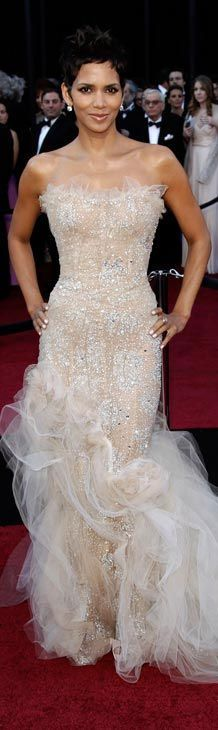 Red carpet fashion dress - Halle Berry in a nude crystal-encrusted Marchesa gown with ruffled train