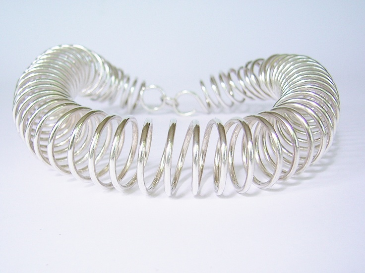 The party neck piece in sterling silver by Michael  Edwards