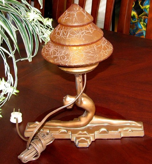 This is a rare art deco lamp it is a signed nuart split girl