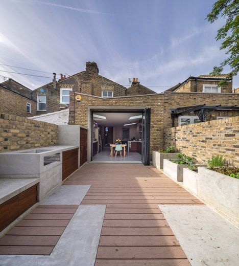 Concrete extends from kitchen to garden at Studio Gil house extension.