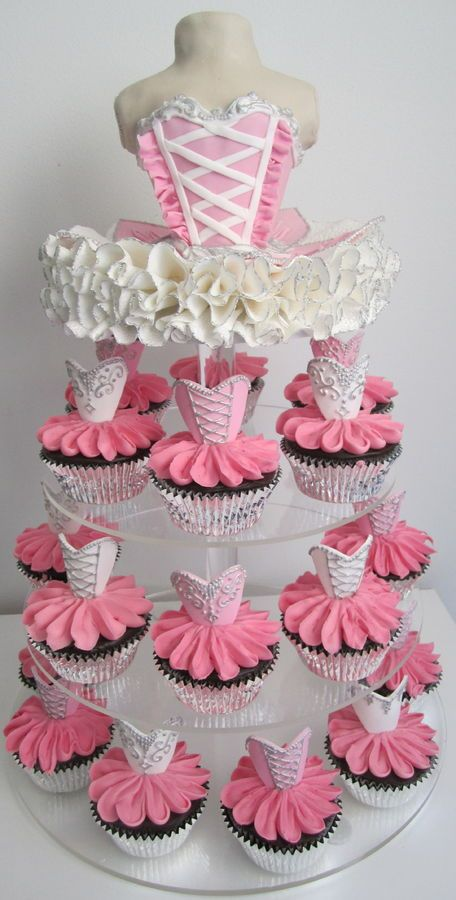 This links to acrylic cake towers for sale...this is design only and no tutorial... you can learn to make the ruffles from ruffle cake tutorialsl in our baking techniques or in our cake tutorial boards... find videos for making fondant or gum paste shapes for the corset on our board or on utube. Ballerina Cupcake tower