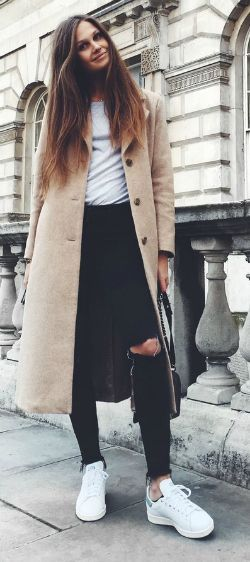 Maxi coats + absolutely in this season + Filippa Hagg + beautiful beige number + distressed denim jeans + plain white tee + simple yet elegant fall style.   Coat/Sneakers: & Other Stories, Jeans: Frame, T-Shirt: Brandy Melville, Bag: Chanel.... | Style Inspiration