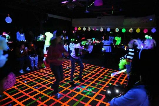 Blacklight Glow Party Dance floor made with neon duct tape.                                                                                                                                                                                 More