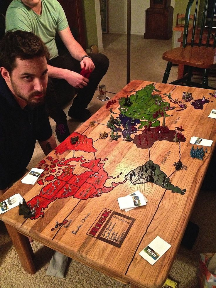 Risk board carved into a coffee table. So sweet! You could paint all sorts or board games instead of carving or print and modge podge onto table top.