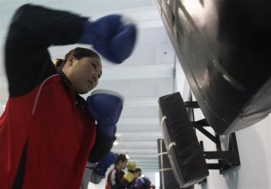 Members of the Vietnam female boxing team practise at a training center in Hanoi February 17, 2012. Vietnam plans to send its boxers to North Korea for training in preparation for the London 2012 Olympic Games in July, according to local media.  REUTERS/Kham