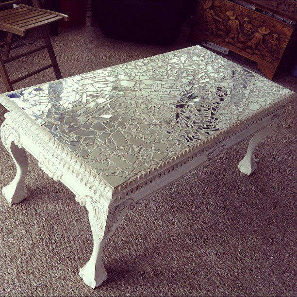 Broken glass on acryllic painted vintage table.