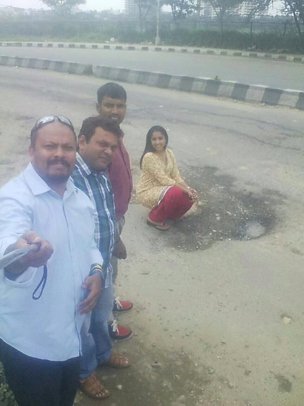 Tired of the pot holed filled roads? Let's wake up the authorities by putting together our #SelfieWithPothole #MissionBengaluru