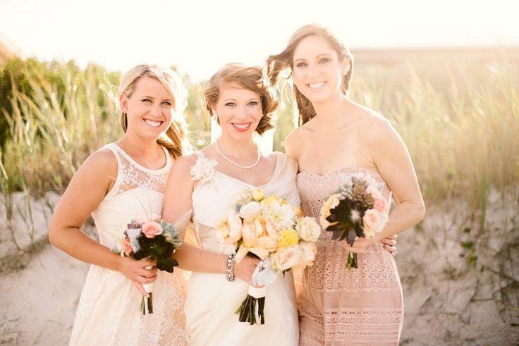 Beachside bouquets in soft shades of sand and sunshine included dahlias, succulents, garden roses, dusty miller, ranunculus, brunia and fountain grass.