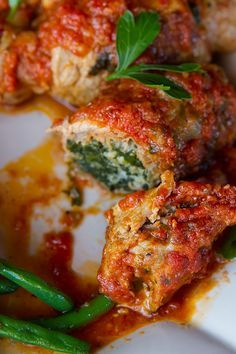 Italian Food Forever » Spinach and Prosciutto Stuffed Veal Rolls {Braciole di Vitello} Chopped spinach flavored with Pecorino Romano cheese and paper thin slices of prosciutto are used as the filling for tender slices of veal scallopini before the veal rolls are simmered in a flavorful tomato sauce in this traditional Italian recipe.