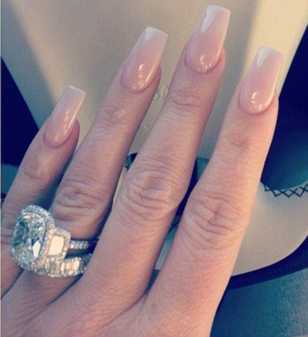 Kim Zolciak shows off a new 10 carat diamond ring #dailymail
