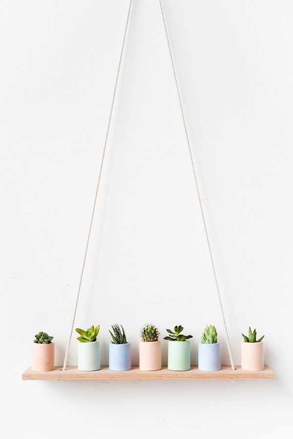 Pastel mini planters on simple DIY shelf   17 Easy DIY Home Decor Craft Projects