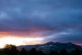 Sunset in Dunedin, New Zealand. On Mt Cargill from the Otago Peninsula. - Click to buy this print, prices start from $49.