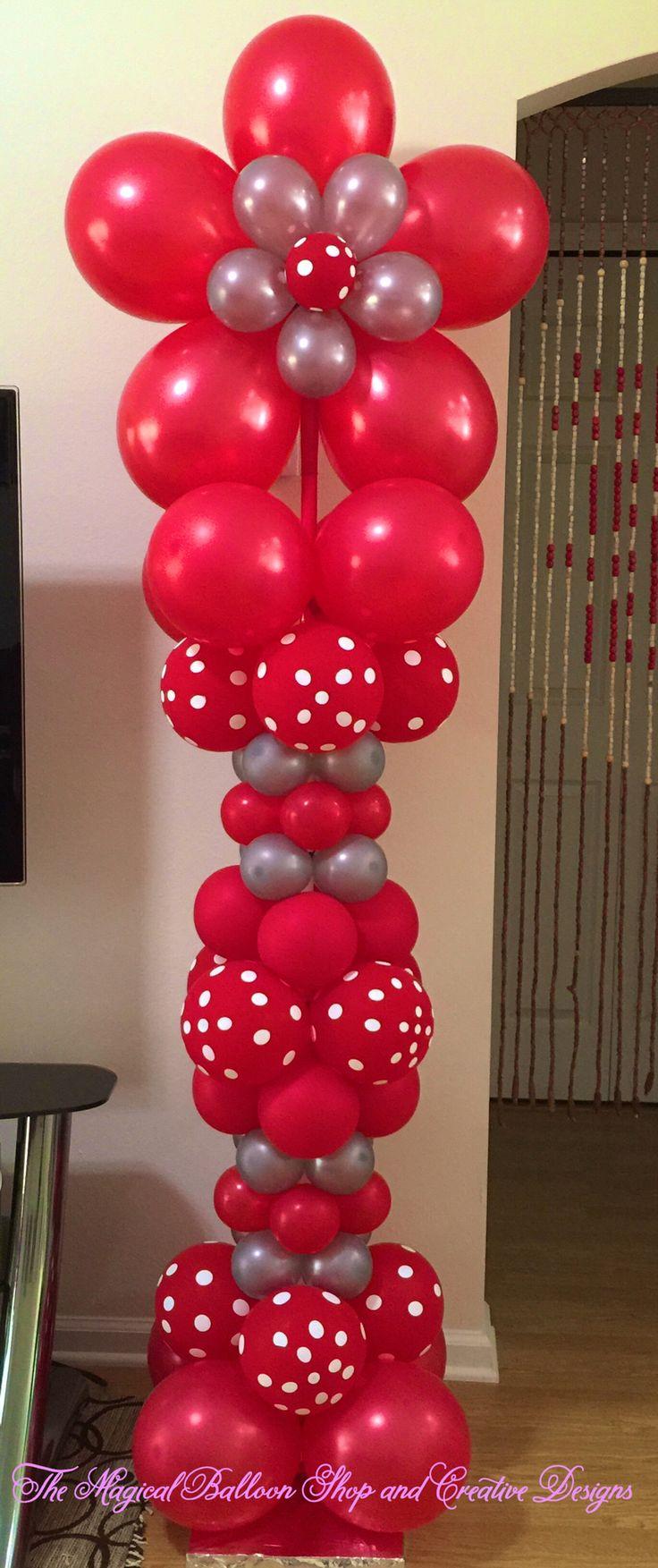 Red polka dot balloon column with flower