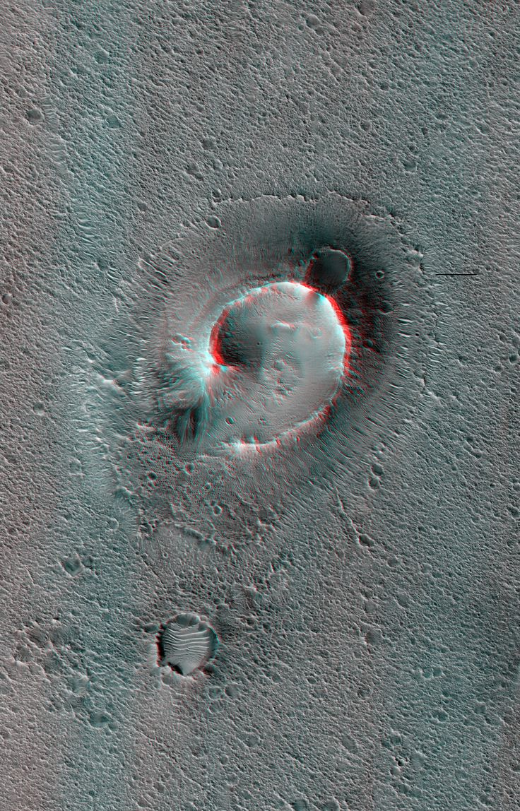 Mound in Chryse Planitia, Mars. An anaglyph (viewable in 3D using red-blue glasses) made from a pair of images acquired by the HiRISE instrument aboard the Mars Reconnaissance Orbiter. The structure shown is about a kilometer across.