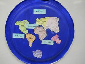 "We glued the 7 continents and 4 oceans onto a painted paper plate. The best part was singing ""We've got the Whole Globe in Ou..."