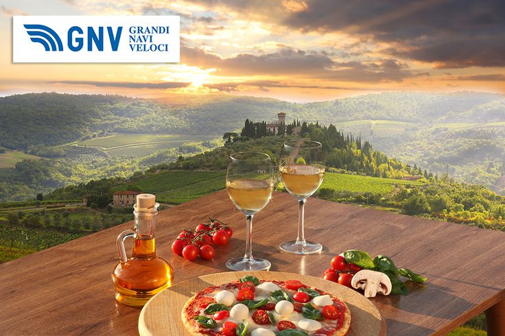 #Italian #pizza and glasses of #white #wine in #Chianti, famous #vineyard landscape in Italy.  Discover GNV here: www.gnv.it/en/