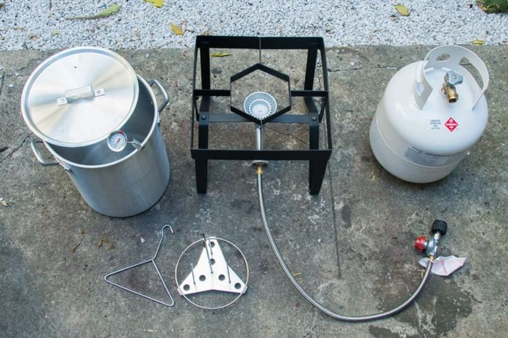 We used a very basic turkey fryer, available here ($64.99), and it worked out great. YOUR TURKEY FRYER SHOULD COME WITH:1) A poultry rack and lifting handle (bottom left corner, above) that you will use to safely move the turkey in and out of the hot oil.2) A frying pot (top left corner, above) that's at least 28 quarts in volume, and a clip thermometer to attach to the side of the pot, for measuring the oil temperature. Our fryer came with a 30-quart pot.3) A sturdy stand, a propane burner…