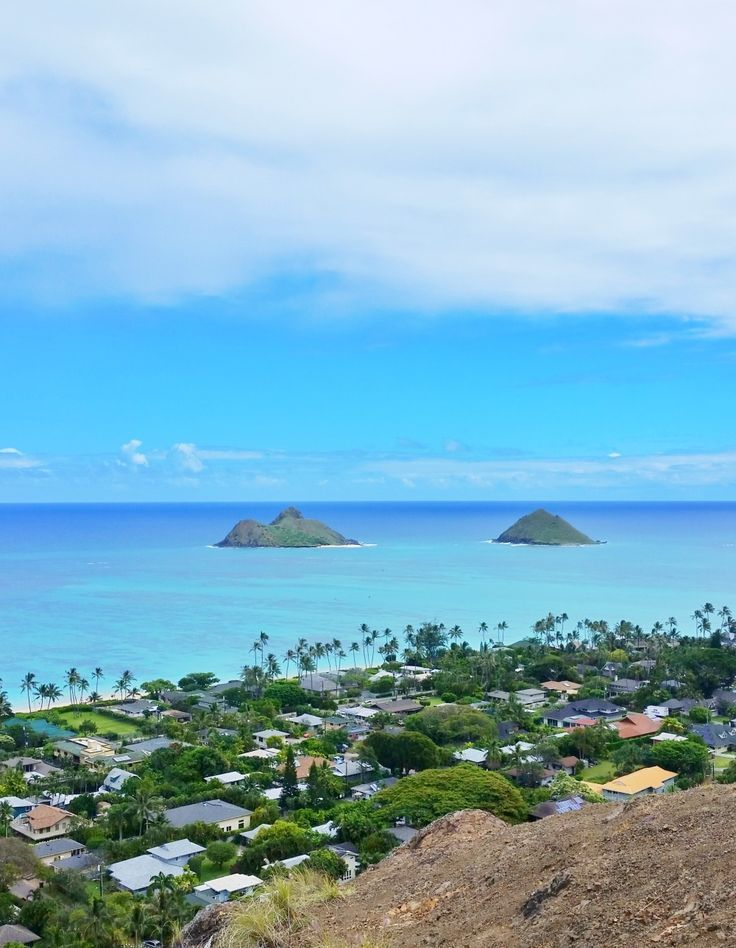 Mokulua islands from Lanikai pillbox hike, Oahu Hawaii hiking trail. For things to do in Oahu, head to Lanikai and Kailua on your Hawaii vacation! Whether your choice of this Hawaii instagram moment is beach, hike, or kayak, it's an outdoor travel destination for the bucket list for budget adventures from Waikiki or Honolulu. With hiking trails and snorkeling, nearby food and restaurants, it's a day of fun activities! So make the planning checklist for your Hawaii packing list to prepare