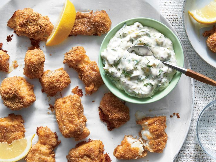 Quinoa-Crusted Fish Nuggets with Tartar Sauce | Frozen fish sticks get a (much-needed) healthy makeover in these family-friendly nuggets. Any firm white fish will work—grouper, halibut, flounder, or cod. Toasted quinoa crust lends earthy flavor and crispy texture while providing an extra dose of protein. If making gluten-free, rice flour works like a charm. Otherwise, you can use all-purpose or whole-wheat flour. Our homemade tartar sauce is enriched with Greek yogurt and fresh dill pickles…