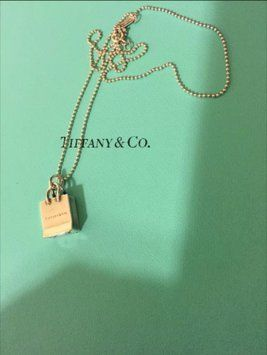 Tiffany Shopping Bag Necklace . Get the lowest price on Tiffany Shopping Bag Necklace  and other fabulous designer clothing and accessories! Shop Tradesy now
