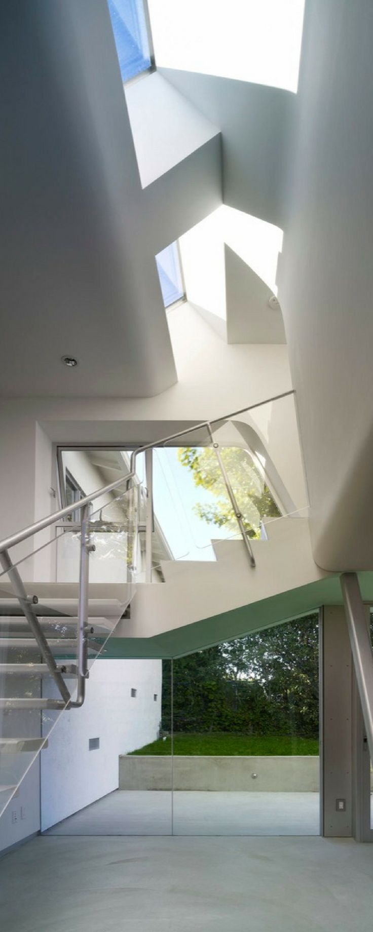 The owners of the Alan Voo House sold many of their unnecessary possessions in an effort to live more simply, inspired by the beautiful style of their newly renovated home. [Alan Voo House, Neil Denari, Architect Neil Denari, Modern House, Minimalist Design, Floor To Ceiling Windows, Concrete Floors, Stainless Steel Staircase]