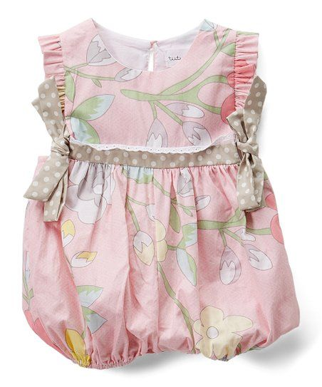 d463ef8b8 Keep Baby looking sweet and feeling comfy in this all-cotton romper that  features darling ruffles and a fresh floral print.