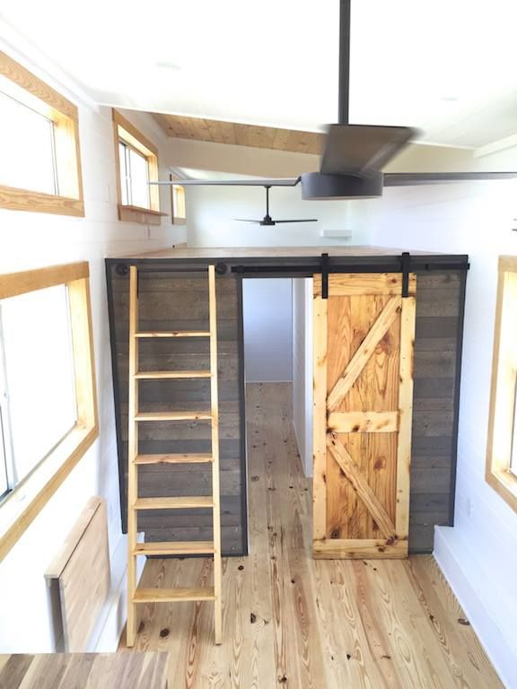 A downstairs master bedroom is located in the rear of the house for extra privacy.