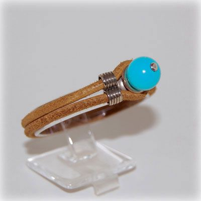 Unisex turquoise bead bracelet with leather band. Handmade in our workshop.