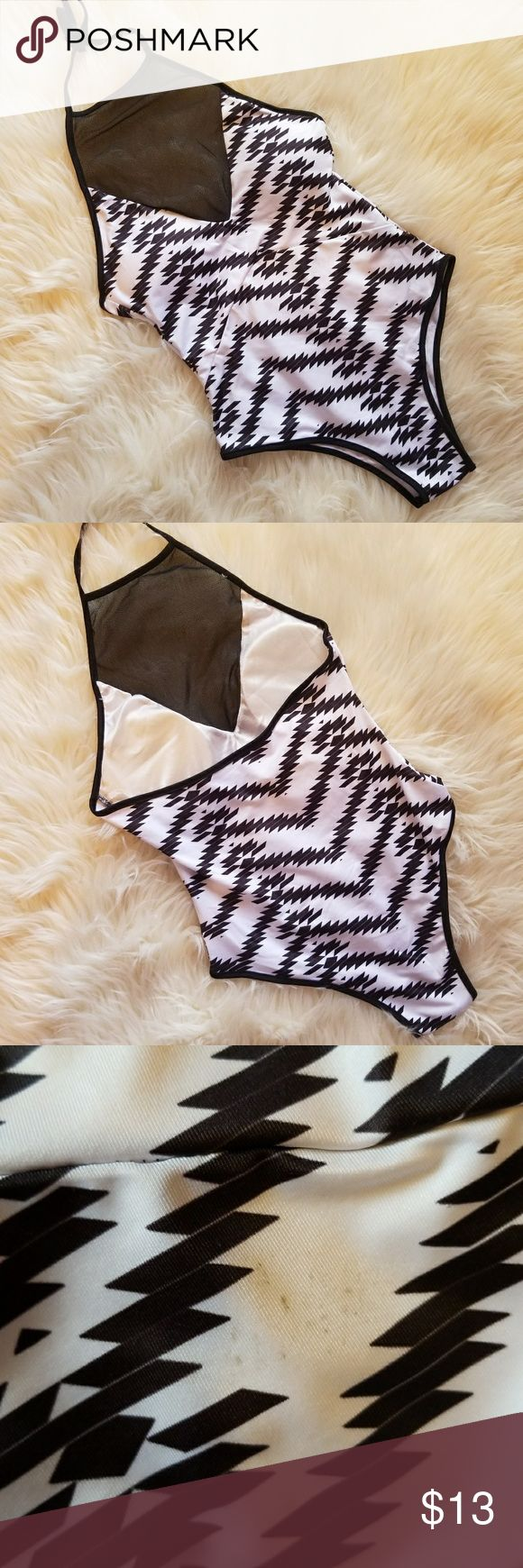 Tribal Print One Piece Bathing Suit Suoer cute bathing suit with a mesh high neck and ties around the neck. Black anf white.  Brand: Boutique Size: Small but no tags. Condition: never worn but it did have a small spot on it when got it. May come out in the washer. Not really noticable.  #bathingsuit #onepiece #tribalprint #meshbarhingsuit #swimsuit #onepiecesuit #swim #seimwear #chicswimwear #chic #summer #summerfashion #summerstyle #fashion #style #cheap #styleforcheap #xoxopf…