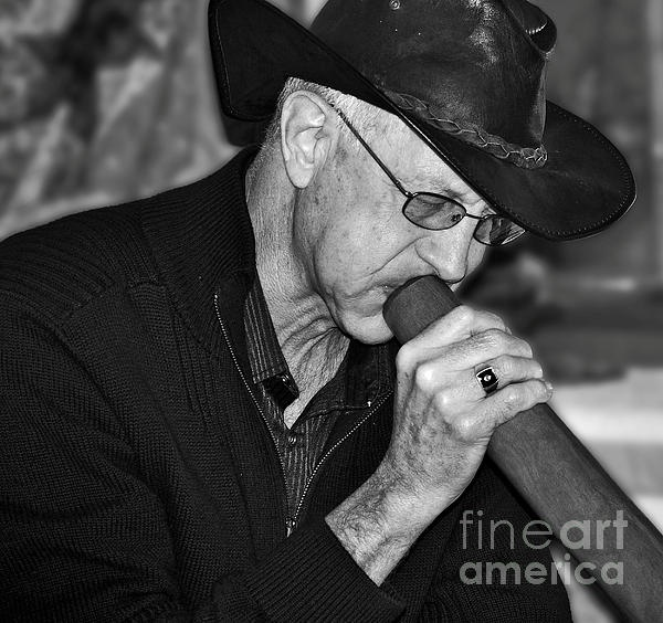 MAN PLAYING THE DIDGERIDOO -   Prints & Greeting Cards available at:  http://kaye-menner.artistwebsites.com/featured/man-playing-the-didgeridoo-kaye-menner.html  -