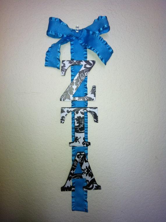 Zeta drop wood letters on a ribbon