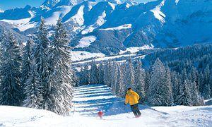 Two skiers on a peaceful piste in Megève