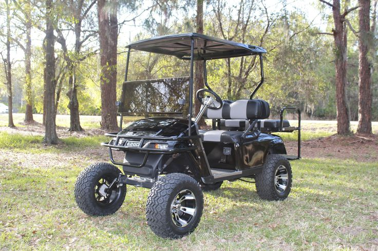 "2008 EZGO TXT/PDS With: Jakes 6"" Spindle Lift, 23"" All Terrain Tires, 12"" SS112 Wheels, Flip Flop Rear Seat, Custom Seats, Carbon Fiber Dash, Carbon Fiber Arm Rests, Carbon Fiber and Chrome Steering Wheel."